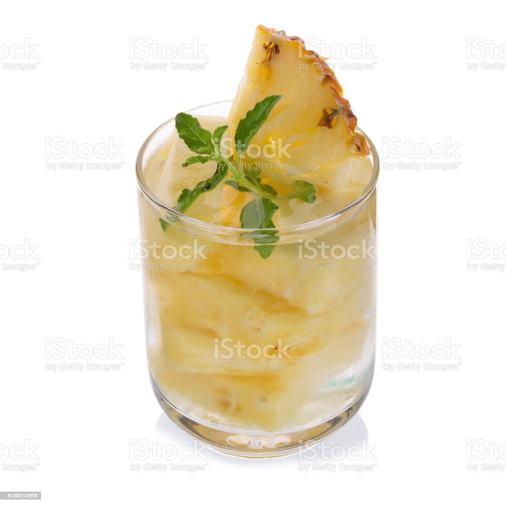 Glasses of pineapple juice with pieces of pineapple healthy drink concept stock photo
