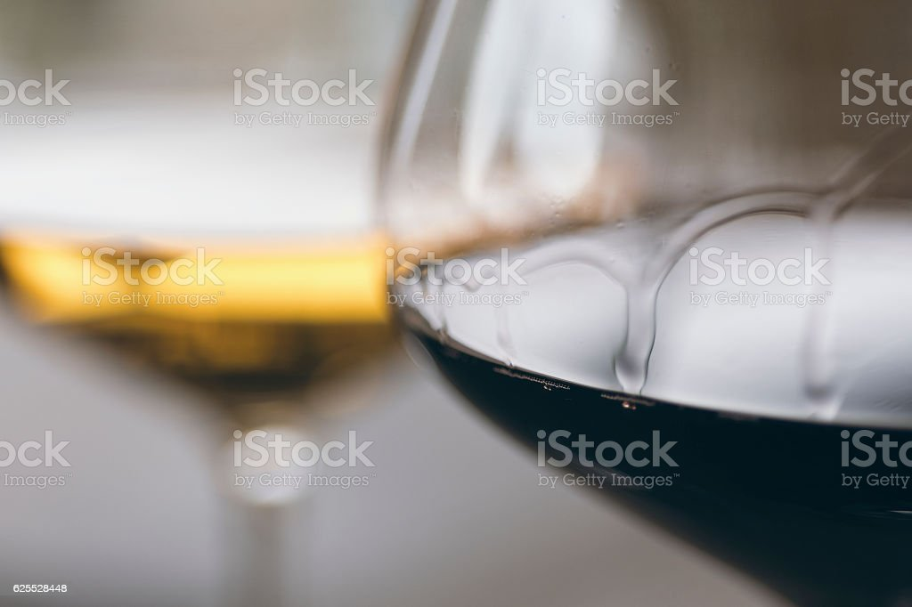 Glasses of Red and White Wine Close Up stock photo