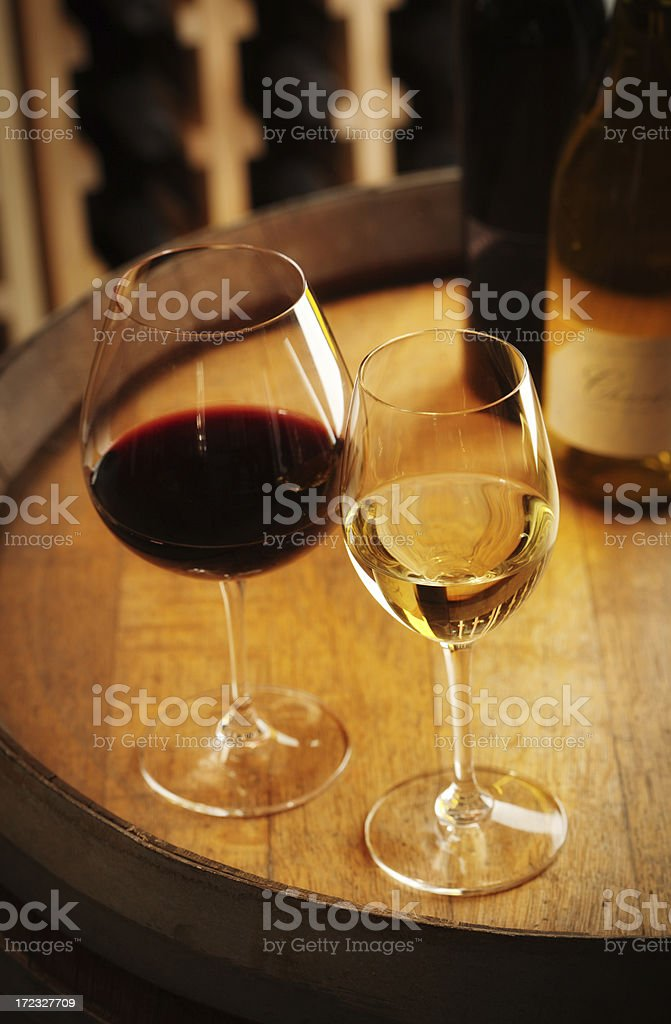 Glasses of Red and White Wine in the Cellar royalty-free stock photo