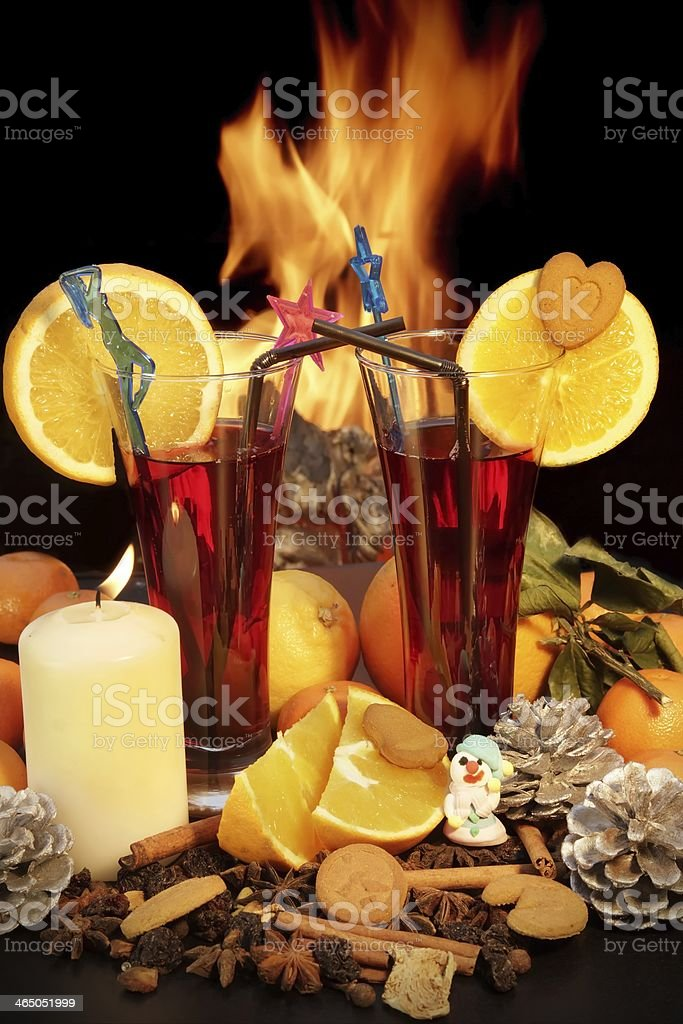 Glasses of red mulled wine and flames in background stock photo