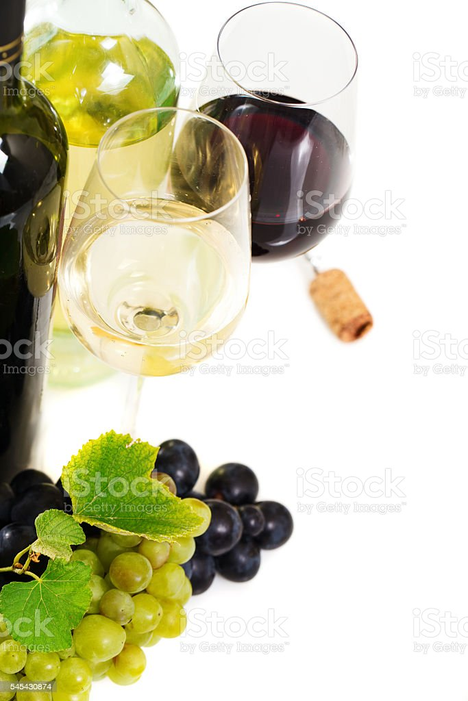 Glasses of red wine, grapes over white stock photo