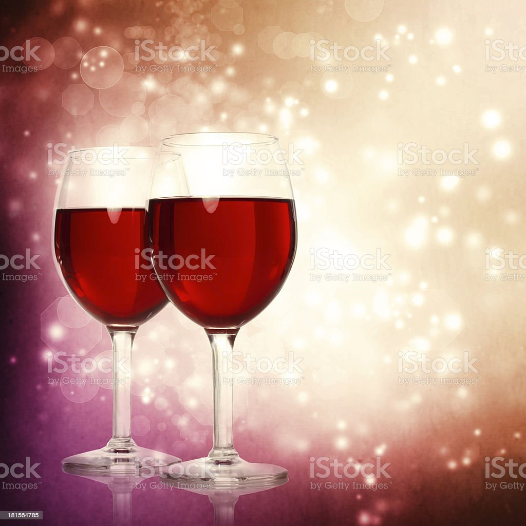 Glasses of Red Wine on a Sparkling Background royalty-free stock photo