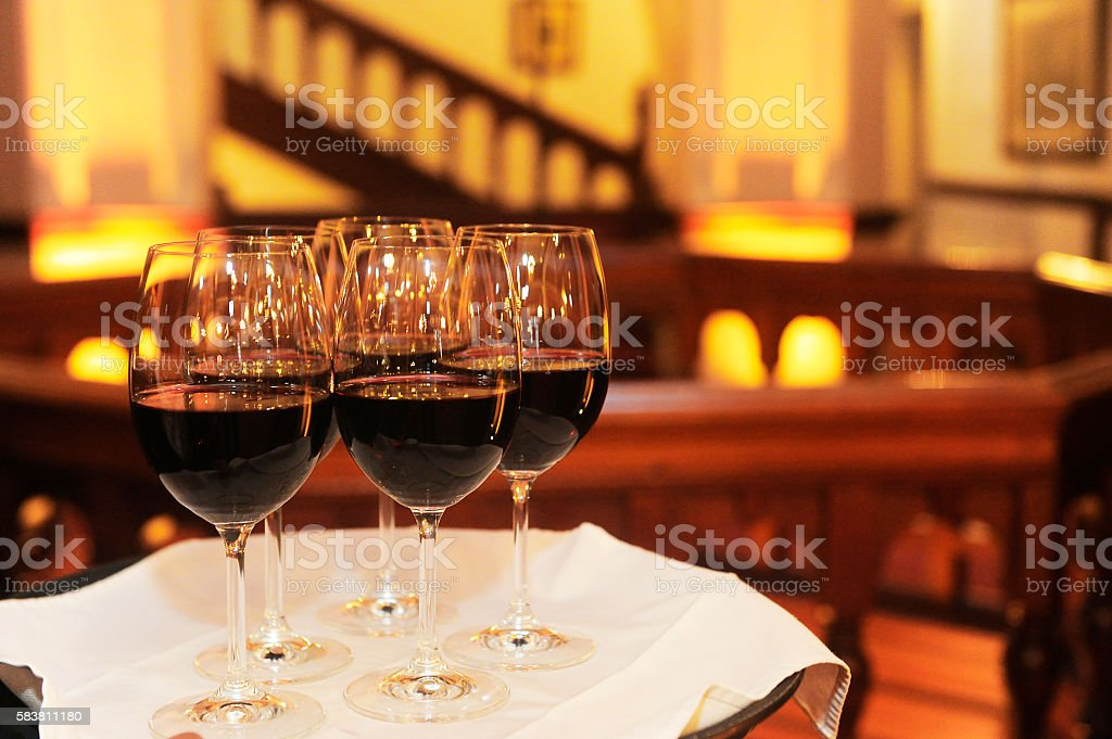 Glasses of red wine on a tray ready to served stock photo