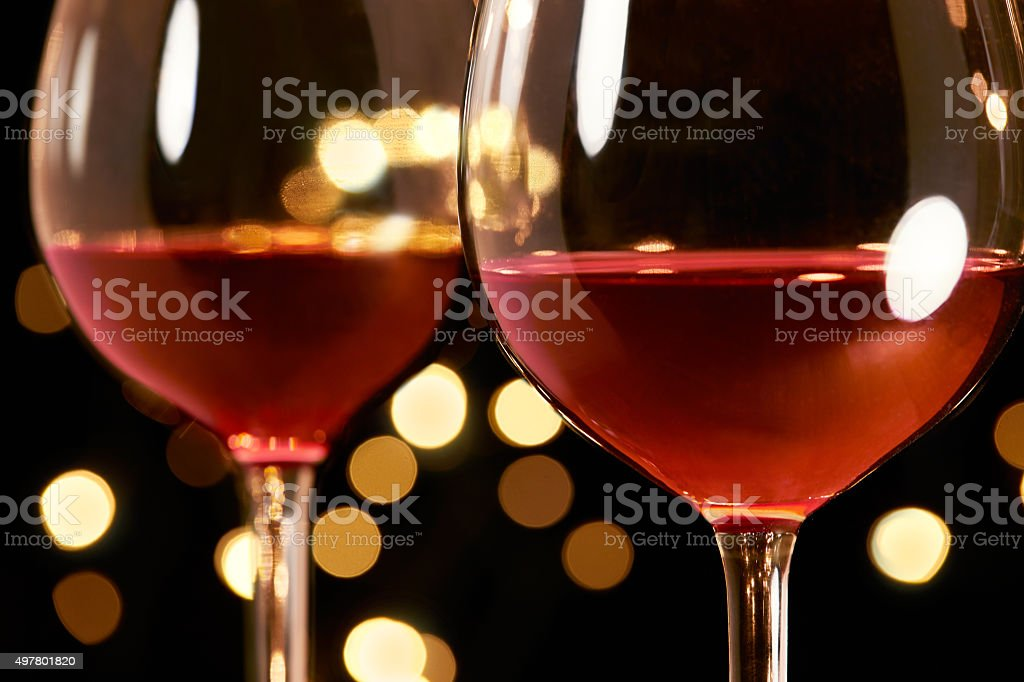2 glasses of red wine. Romantic dinner. stock photo