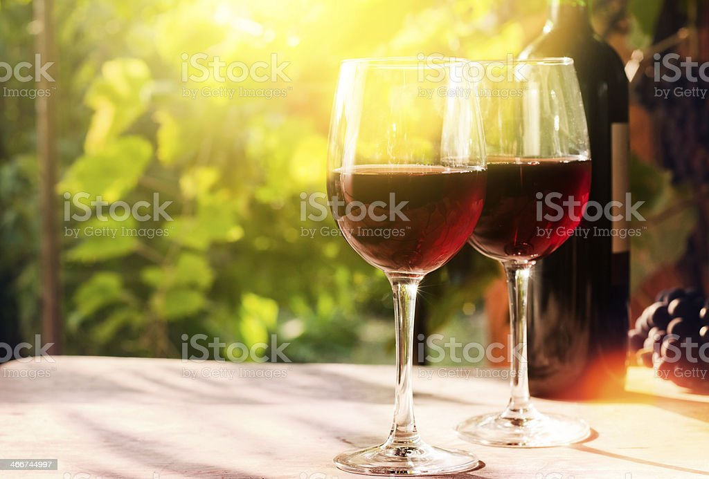 Glasses of red wine with bottle royalty-free stock photo