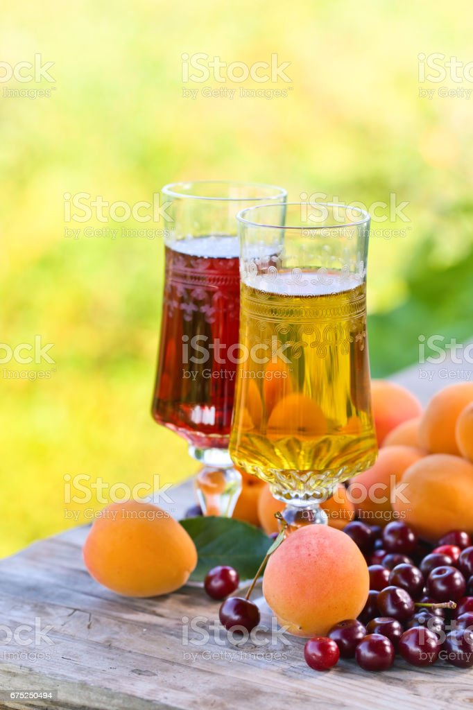 Glasses of sweet white and fruits on wooden table stock photo