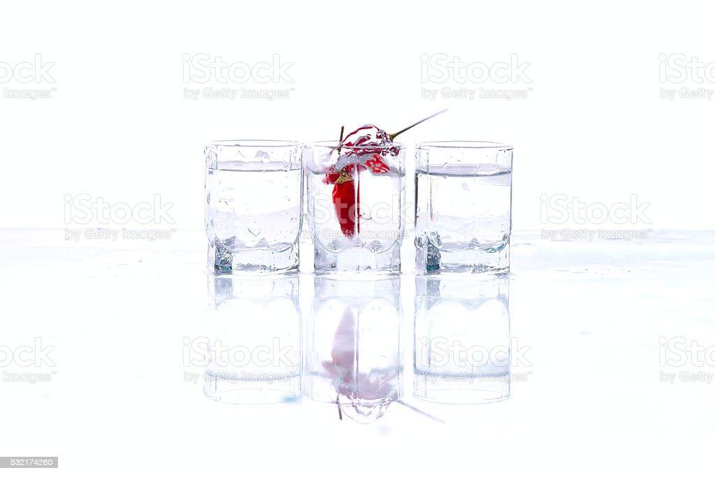 Glasses of vodka and chilli stock photo
