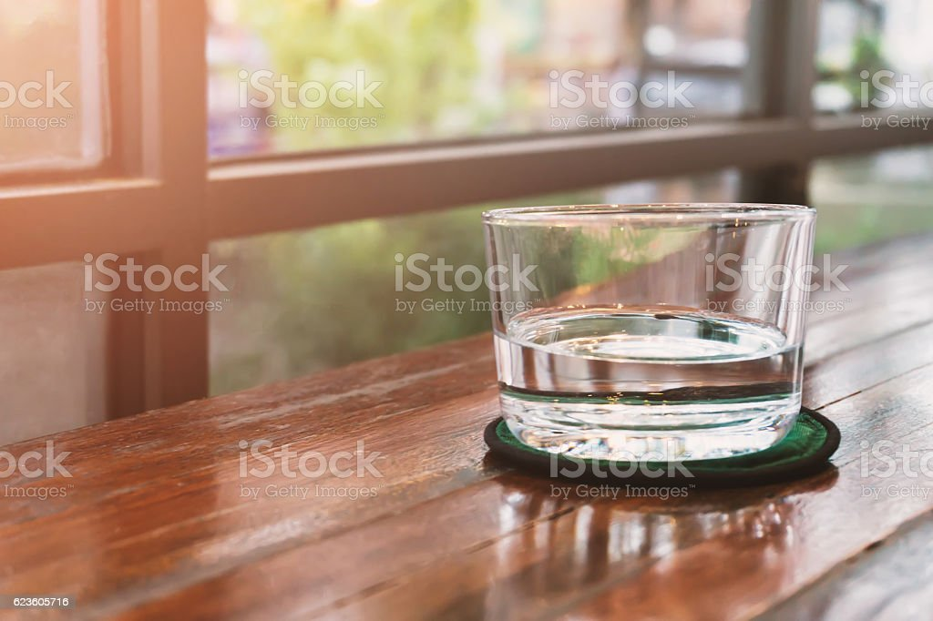 Glasses of water on a wooden table. Selective focus. Shallow stock photo