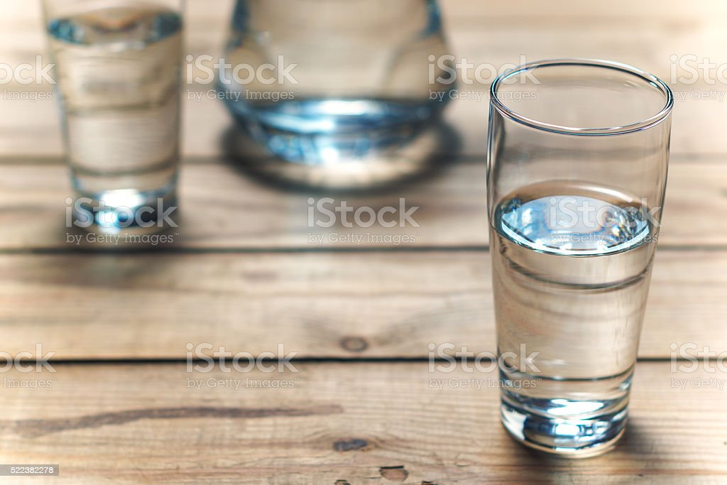 Glasses of water on wooden table. Selective focus. stock photo