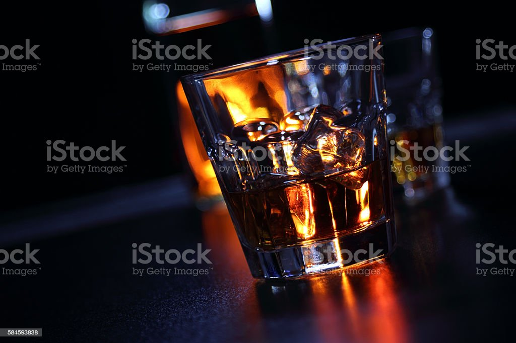 Glasses of whiskey on the bar stock photo
