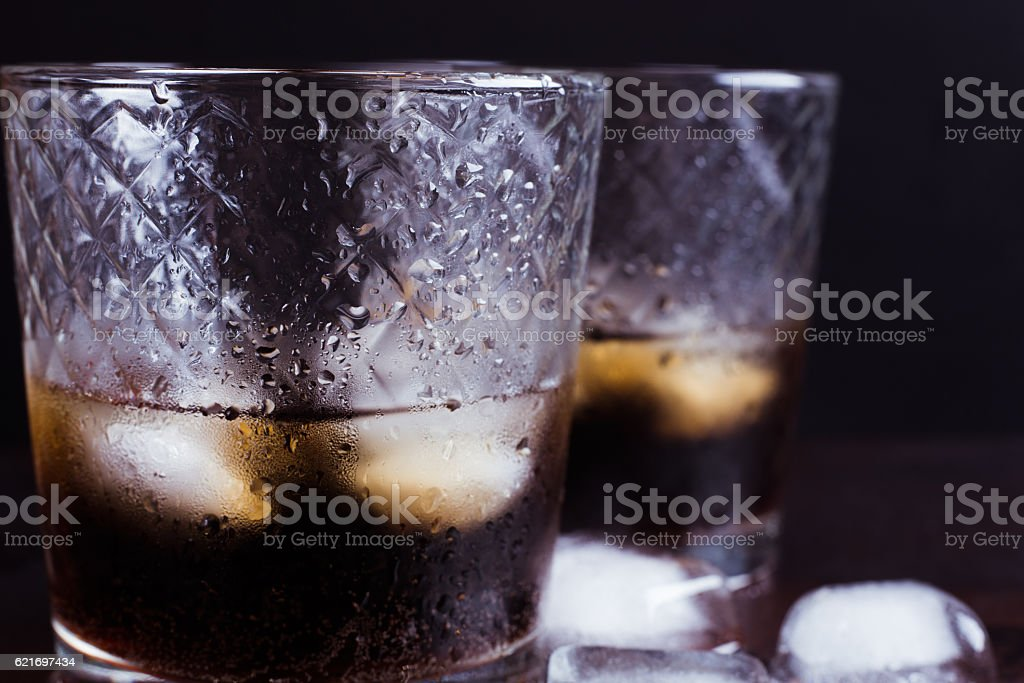 Glasses of whiskey or cola cocktail stock photo
