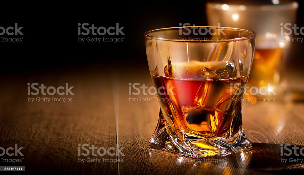 Glasses of whiskey stock photo