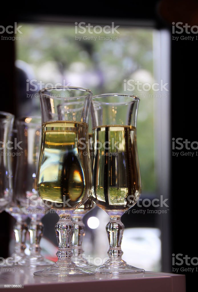 Glasses of white wine on the bar stock photo