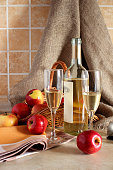 Glasses of wine and a basket of apples..