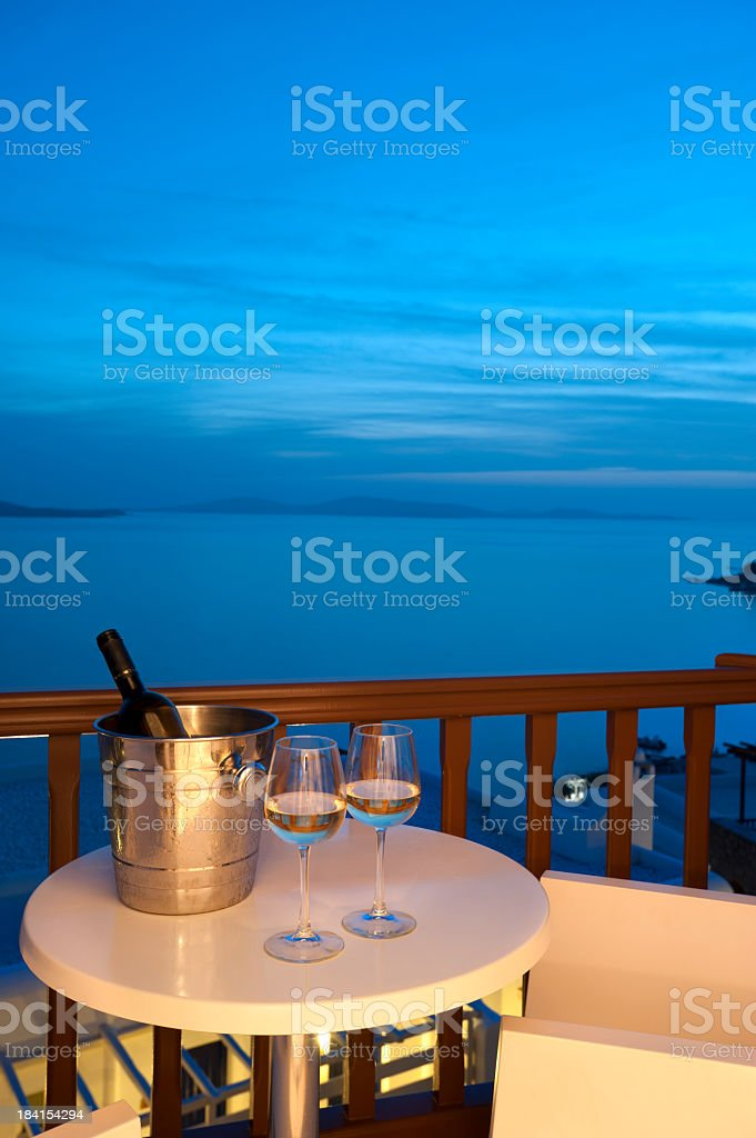 Glasses of wine with an ice bucket stock photo