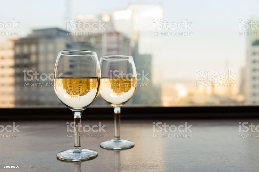 Glasses of wine with city view. stock photo