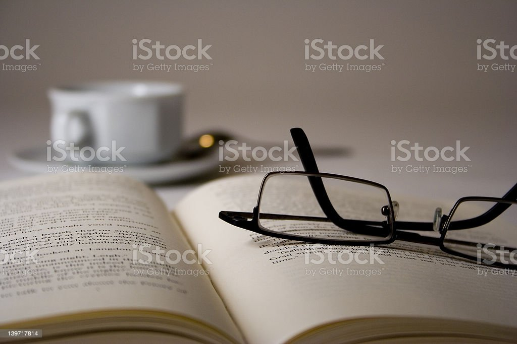 Glasses on a book royalty-free stock photo