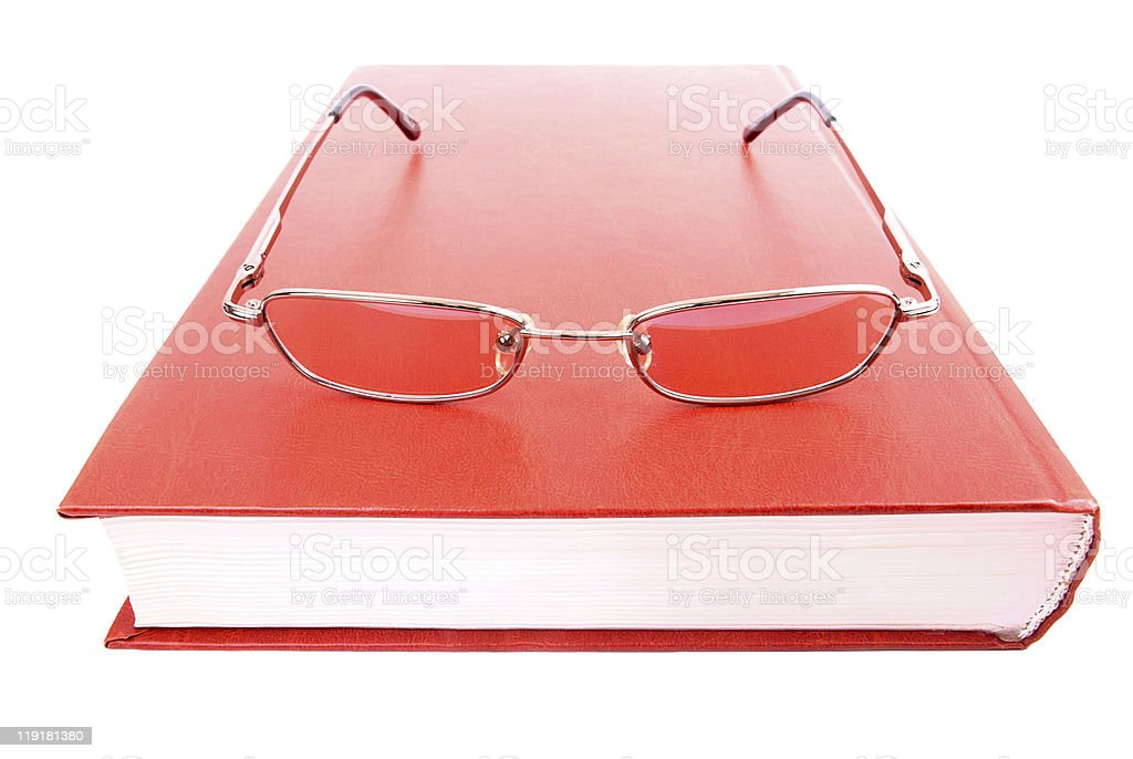 Glasses on a closed book royalty-free stock photo