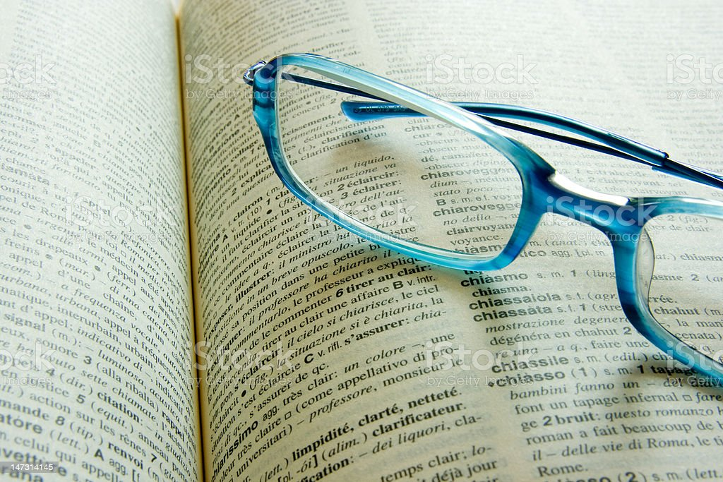 Glasses on a dictionary stock photo
