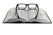 glasses on a dictionary