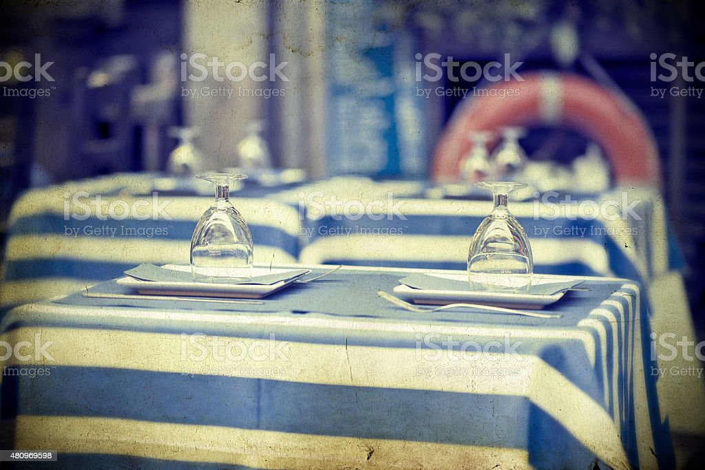 Glasses on a dining table - sailor styled terrace stock photo