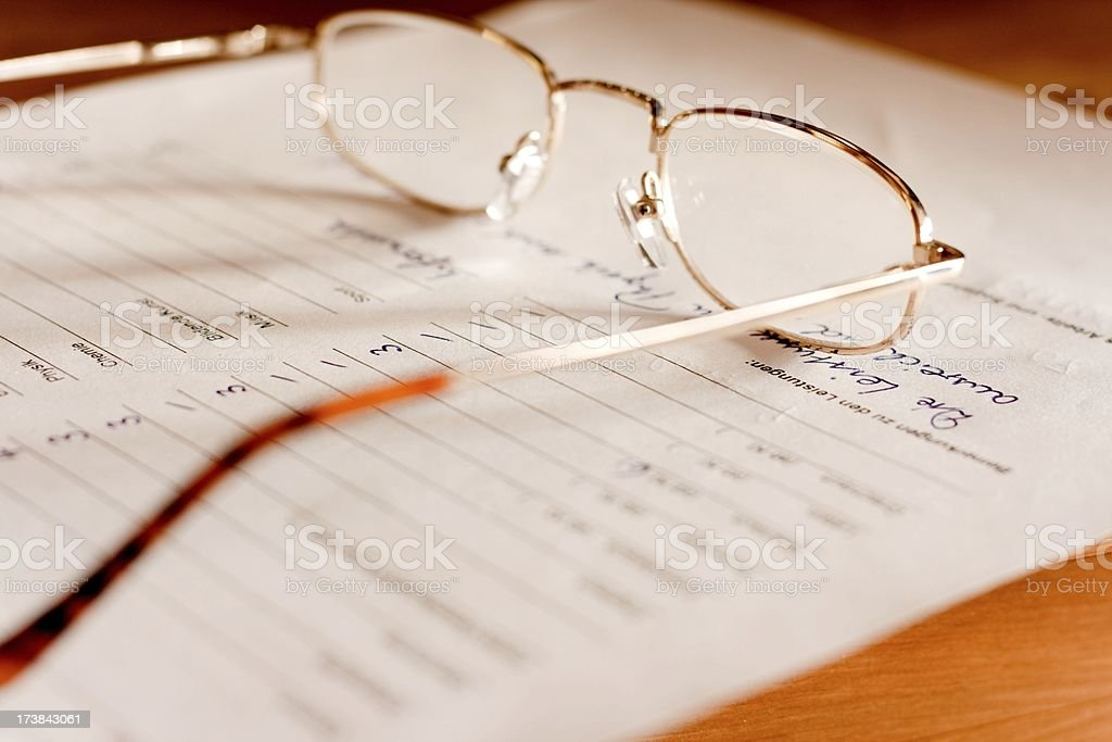 glasses on a german high school attestation / Document stock photo