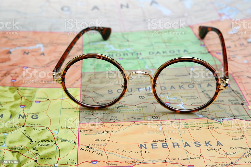 Glasses on a map of USA - South Dakota stock photo