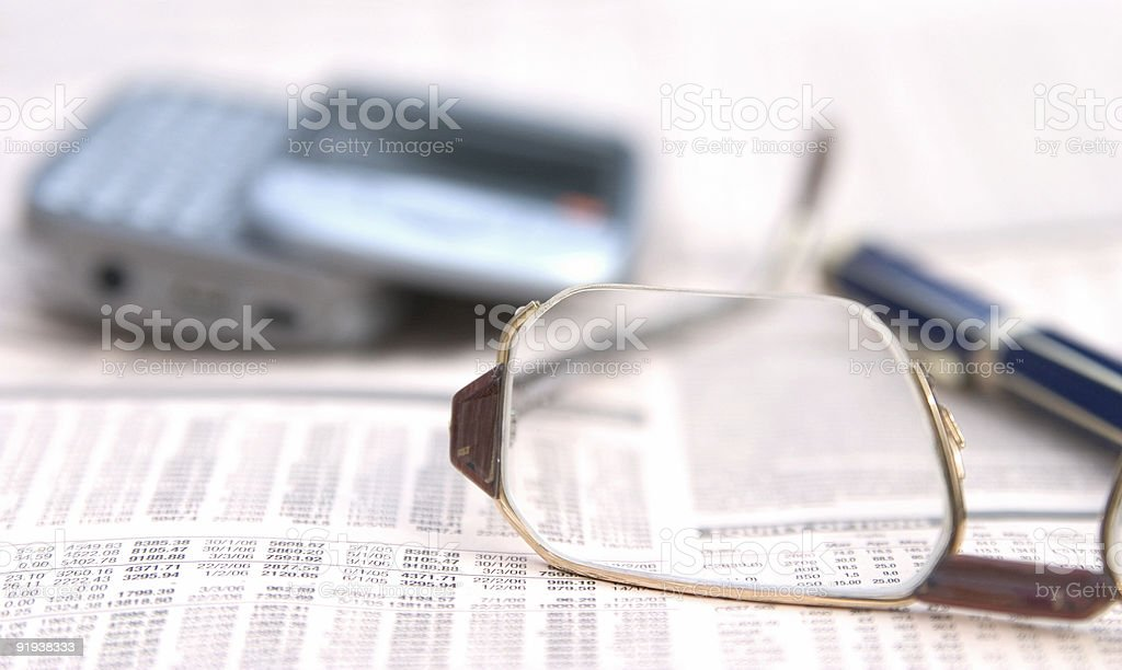 Glasses on a newspaper royalty-free stock photo
