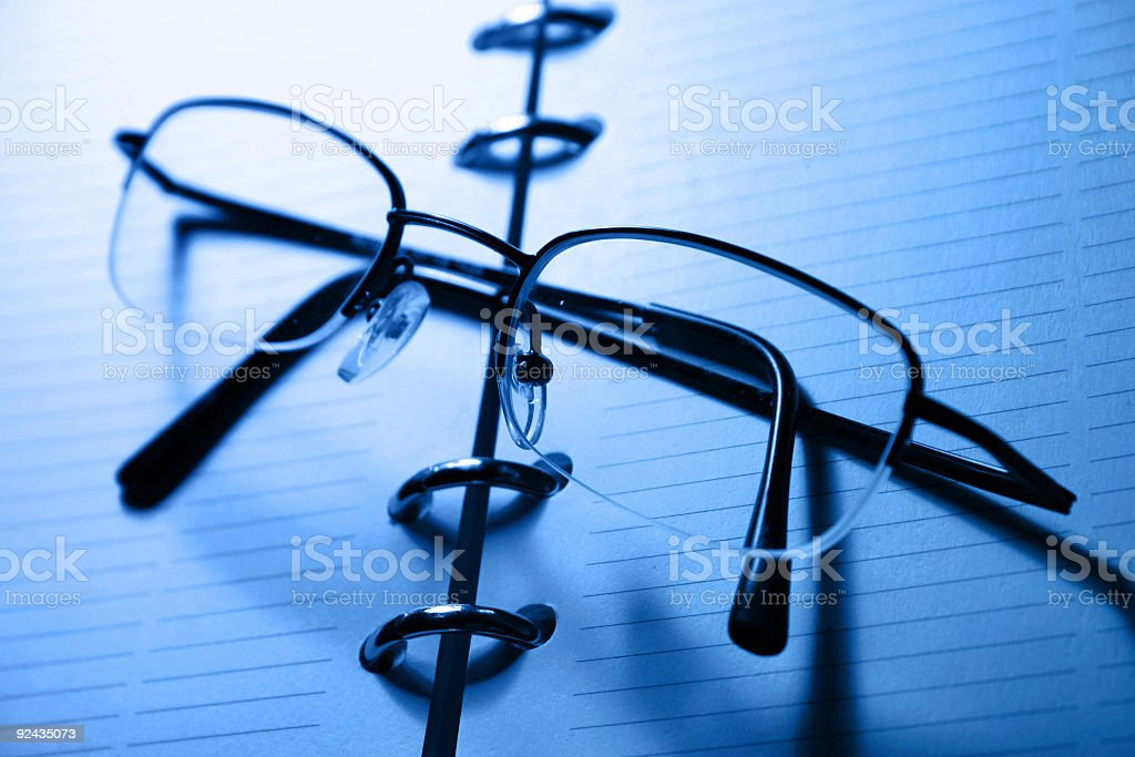 Glasses on a notebook II stock photo
