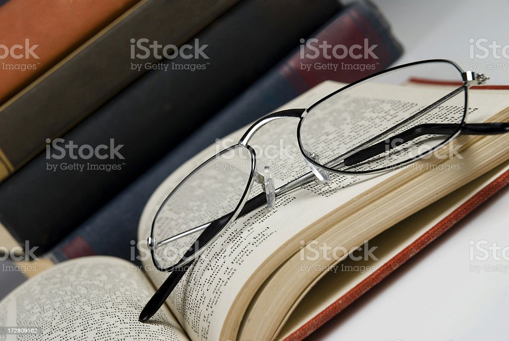 Glasses on a vintage book royalty-free stock photo