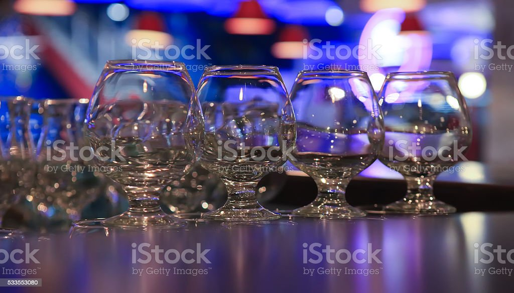 glasses on an arm over bar counter stock photo