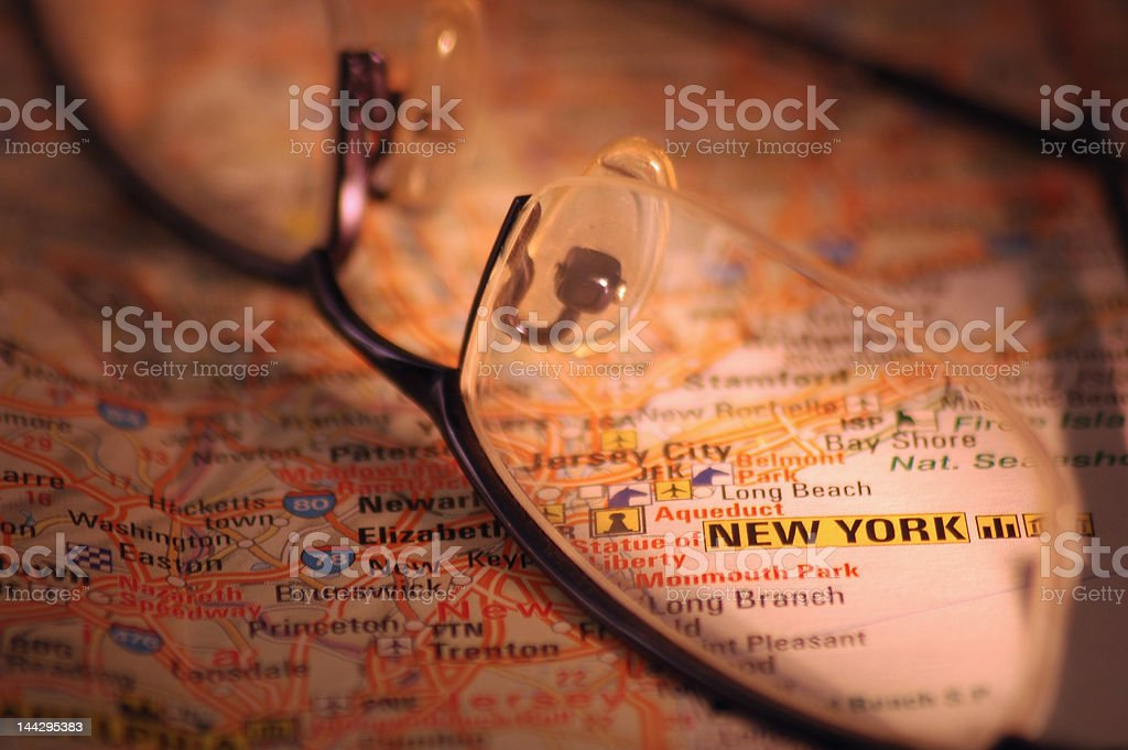 glasses on an map royalty-free stock photo