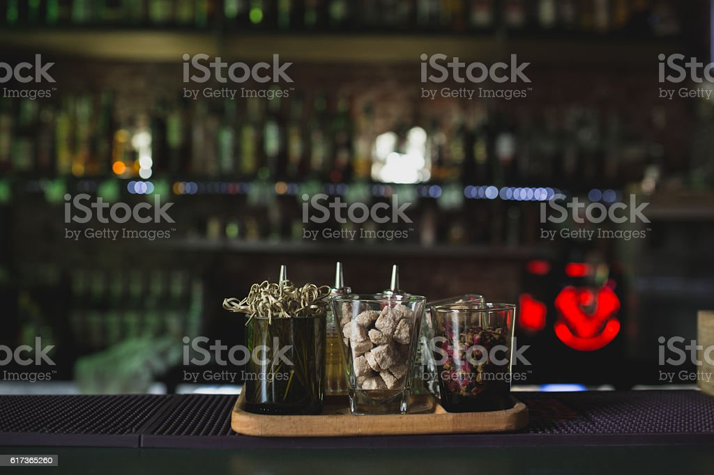 Glasses on bar table, refreshing drinks with straws. stock photo
