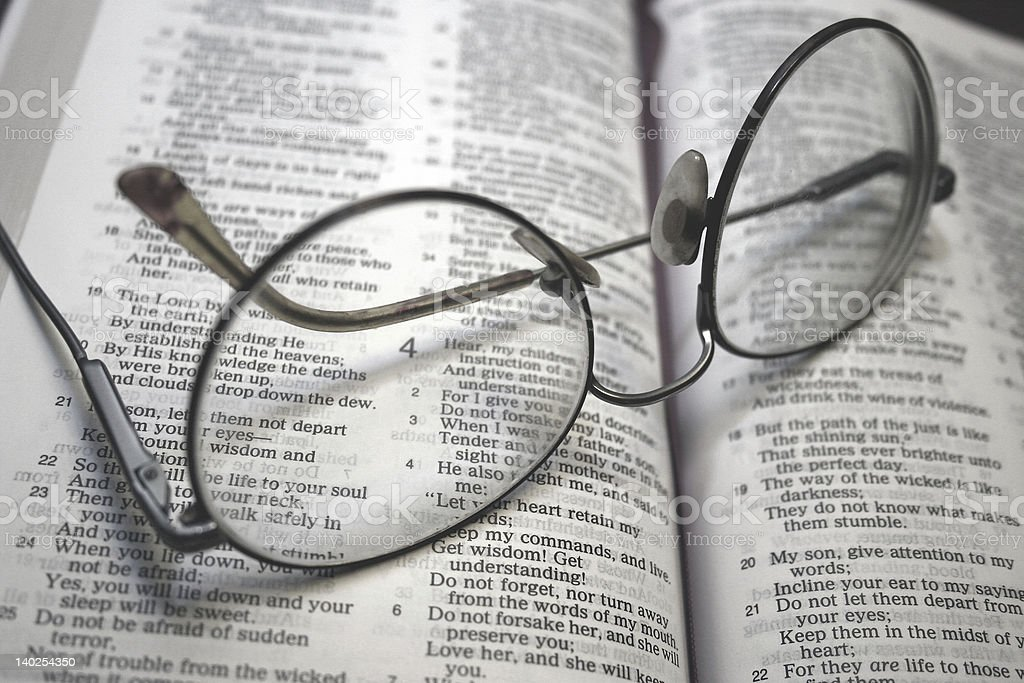 Glasses on Bible stock photo