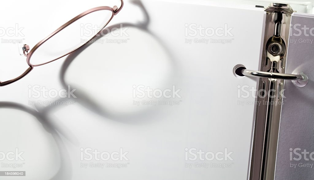 Glasses on Binder stock photo