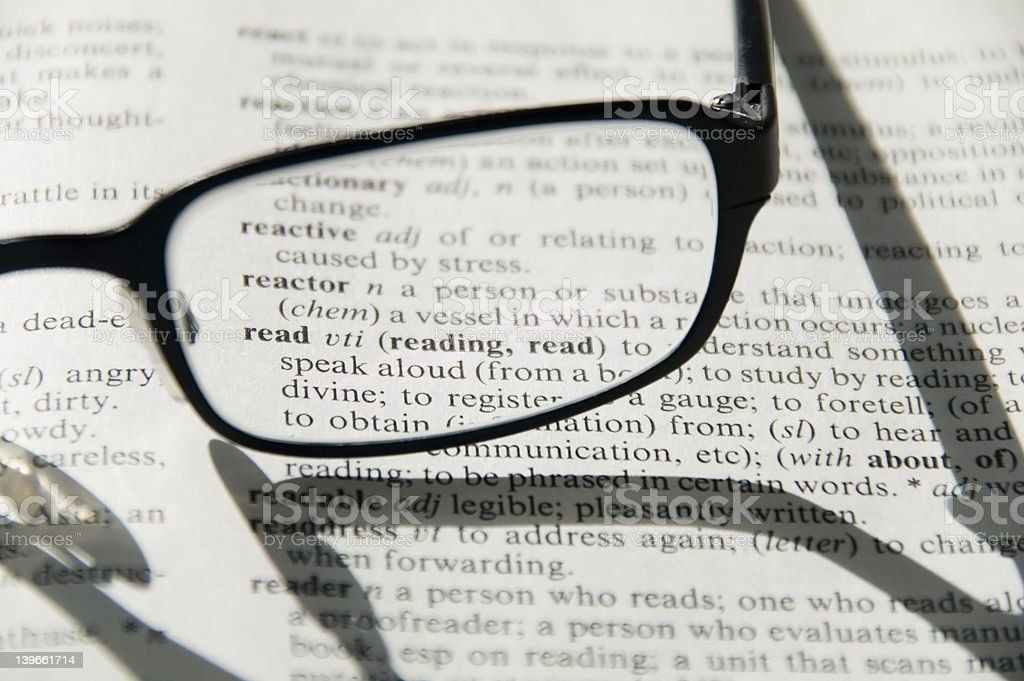 Glasses on dictionary, detail royalty-free stock photo