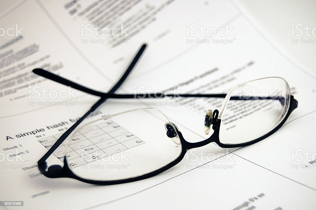Glasses on lecture notes royalty-free stock photo