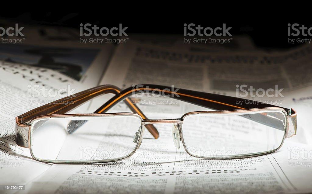Glasses on newspaper stock photo