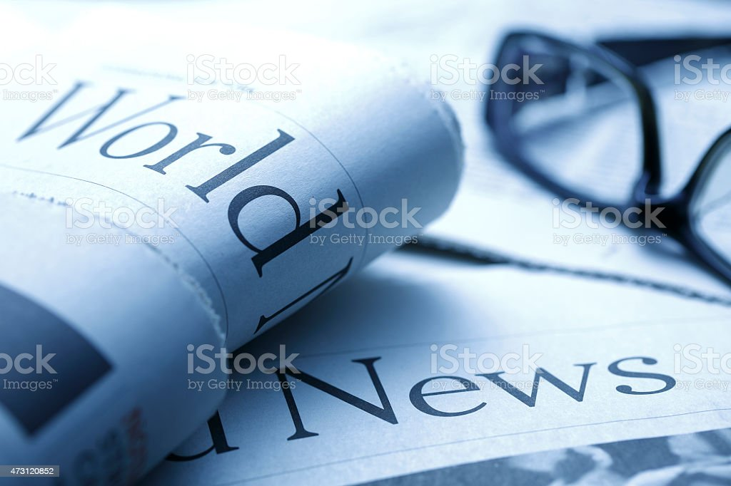 Glasses on newspaper stock photo