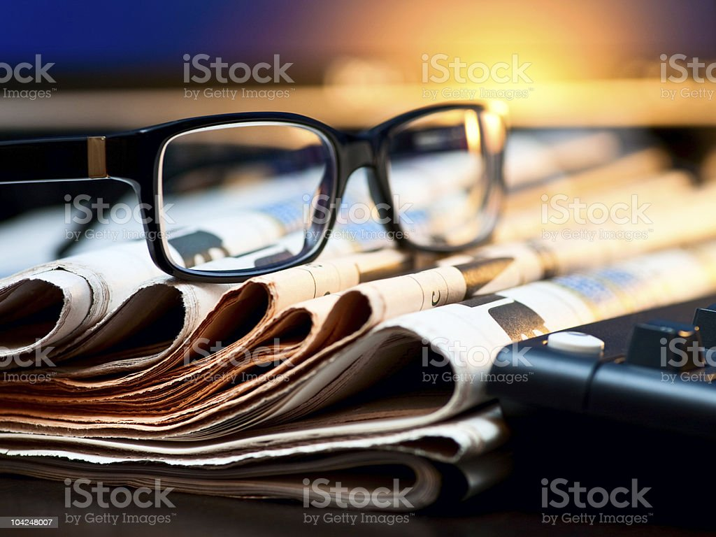 Glasses on newspapers stock photo