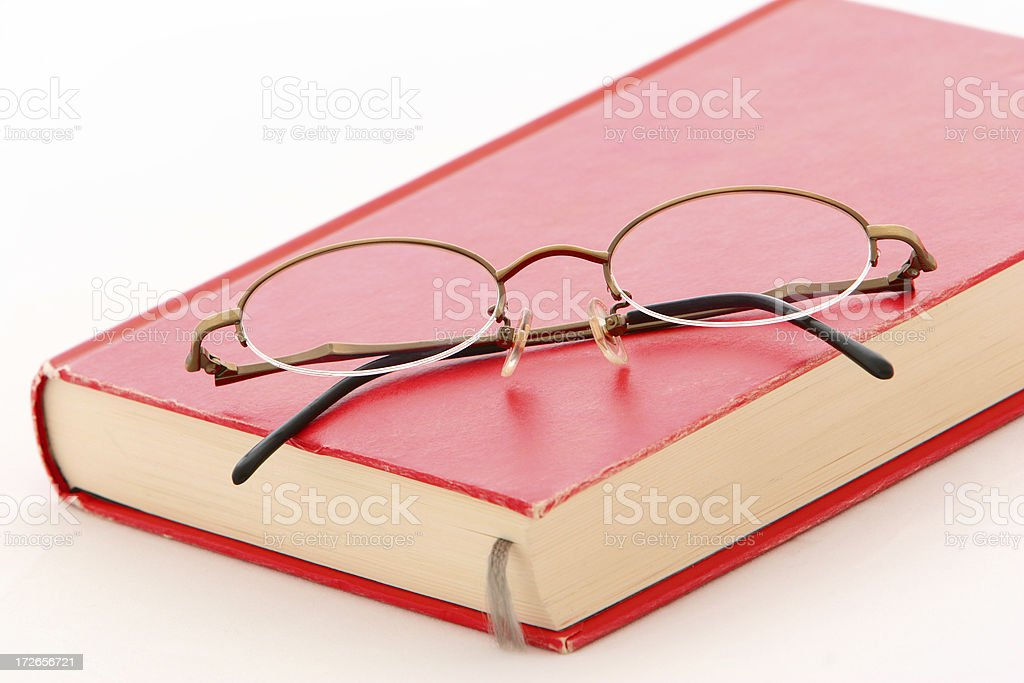 Glasses on red book royalty-free stock photo