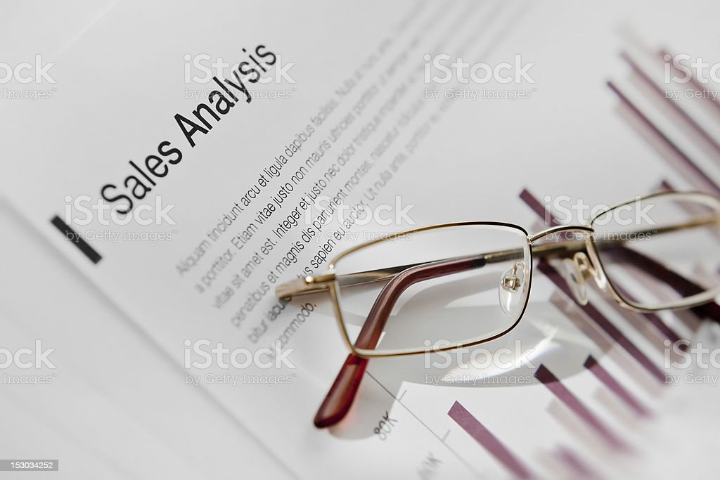 glasses on report document stock photo