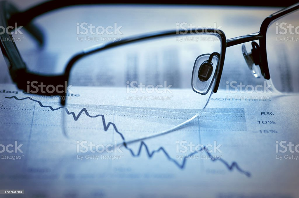 Glasses on stock chart royalty-free stock photo