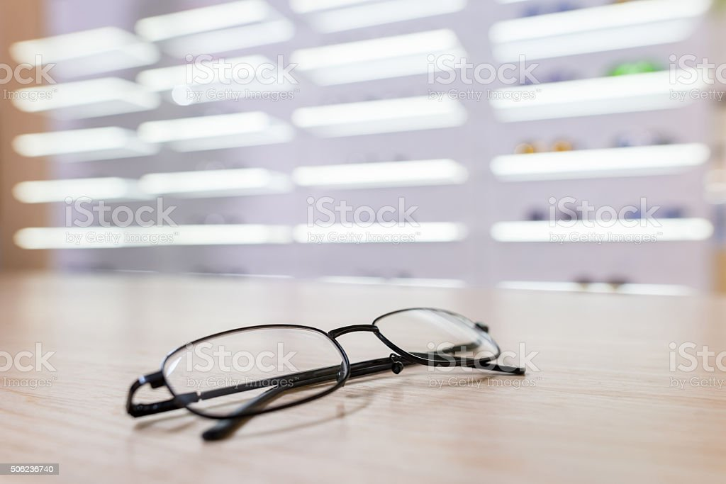 Glasses on the counter of an optics stock photo