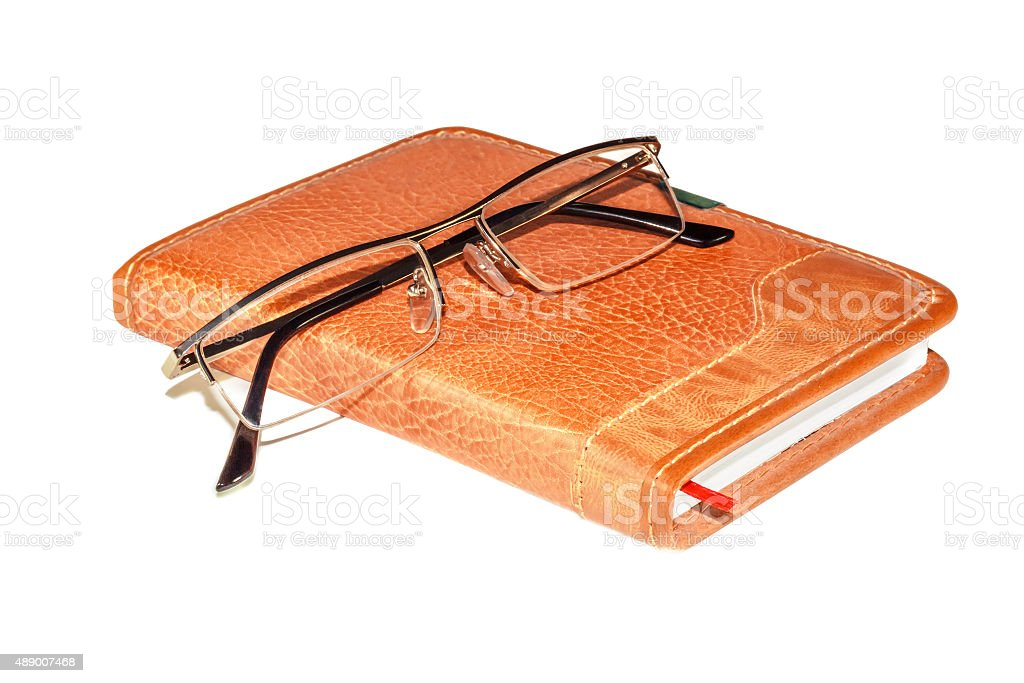 Glasses on the notebook stock photo