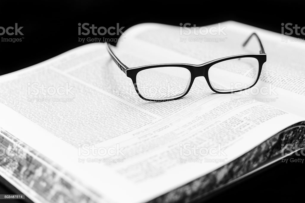 Glasses on the Talmud. Background Torah study stock photo