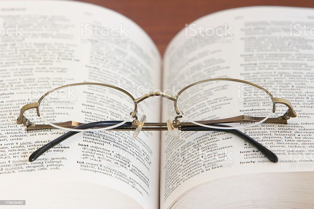Glasses on thesaurus royalty-free stock photo
