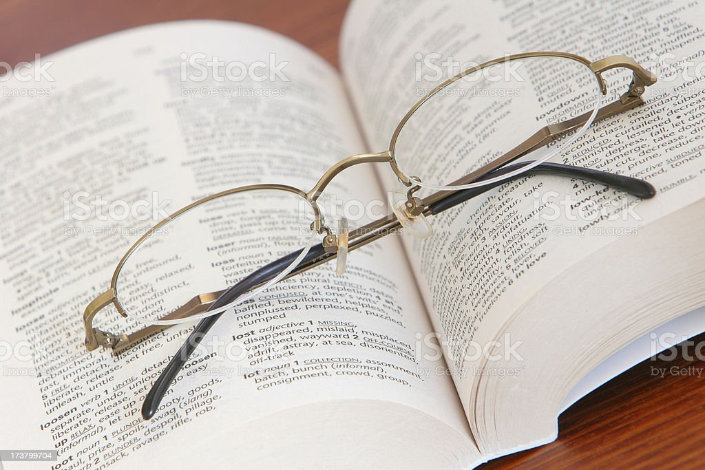 Glasses on thesaurus royalty-free stock photo