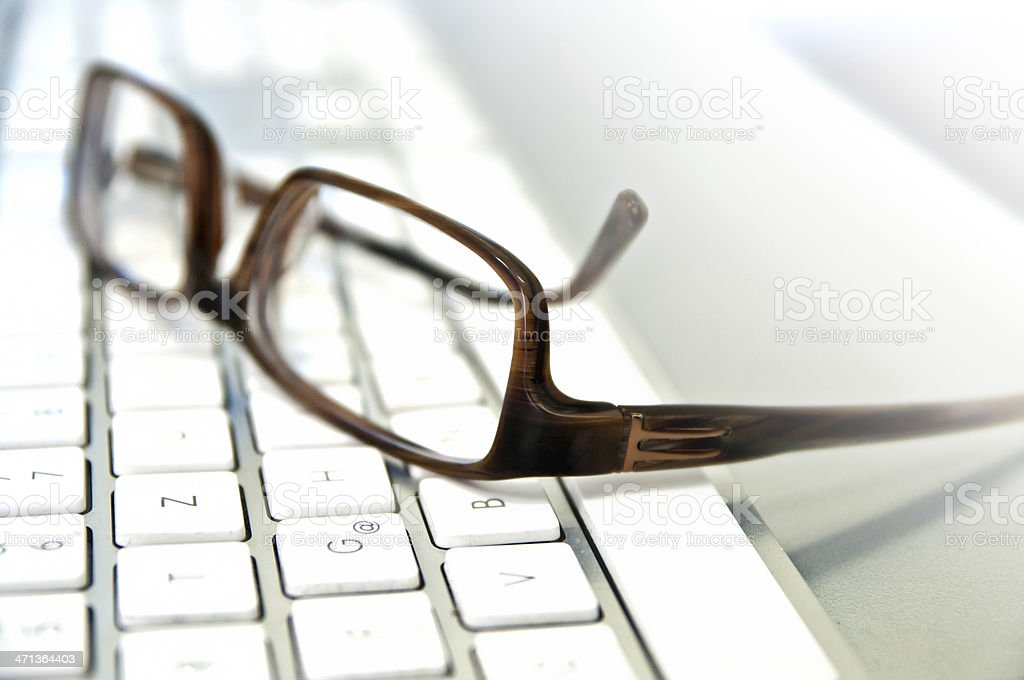 glasses on top of laptop keyboard. royalty-free stock photo