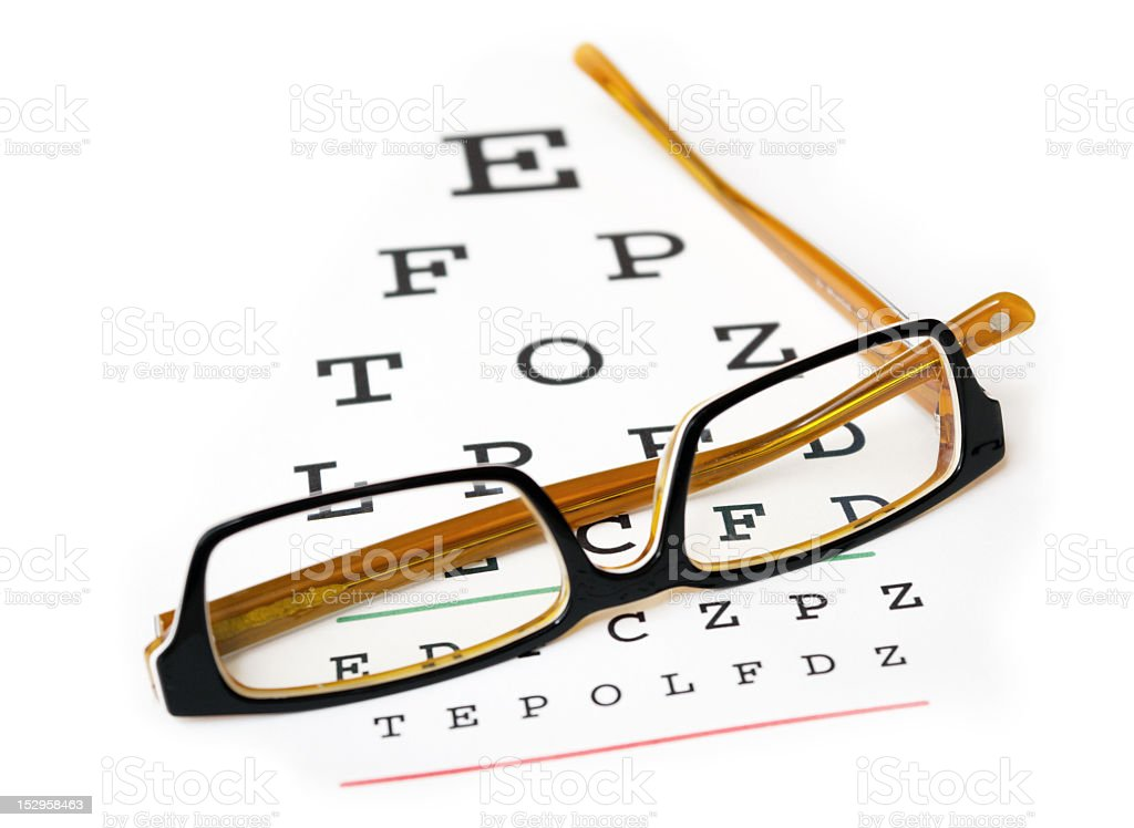 Glasses on top on eye sight test stock photo